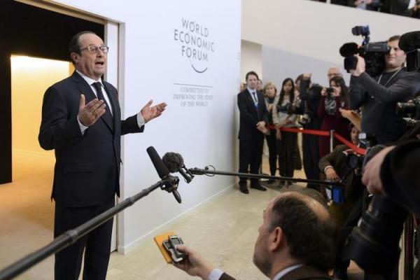 709914-le-president-francais-francois-hollande-s-exprime-devant-des-journalistes-au-forum-economique-mondia.jpg